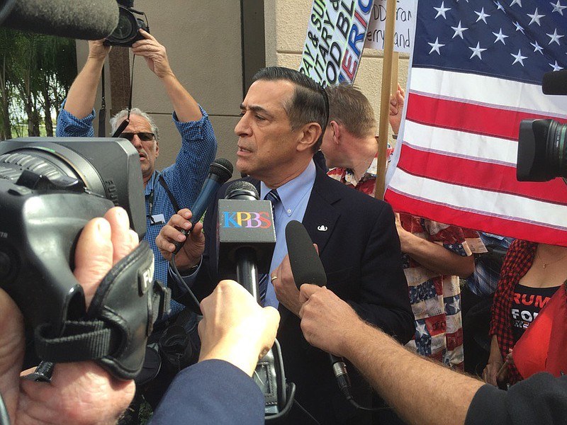 Rep. Darrell Issa, R-Vista talks to supporters and protesters outside of his ...