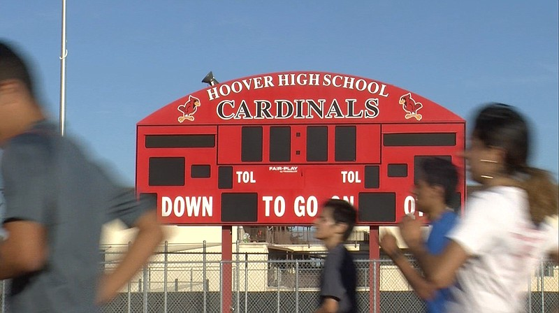 Student athletes run past a scoreboard at Hoover High School in San Diego's C...
