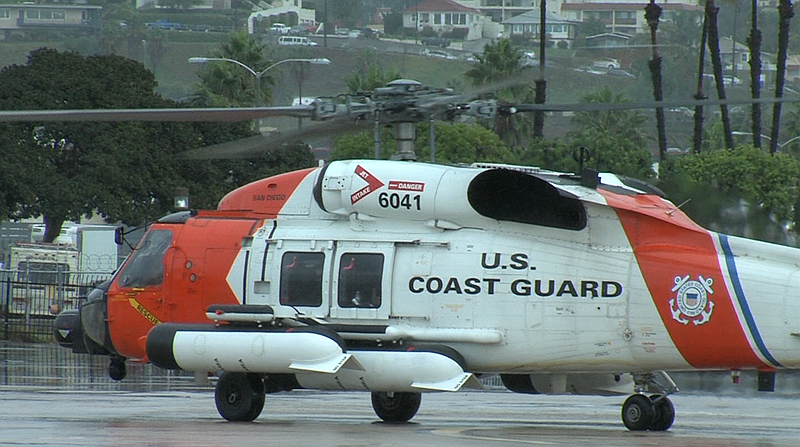 A Coast Guard helicopter lands at the San Diego Coast Guard Air Station, Feb....