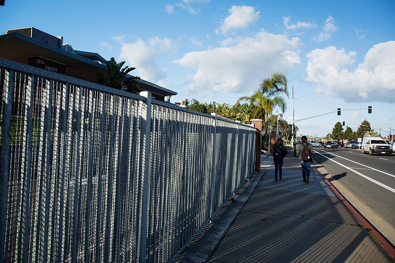 Two students walk past the front gate of Emory Elementary on Feb. 23, 2017. T...