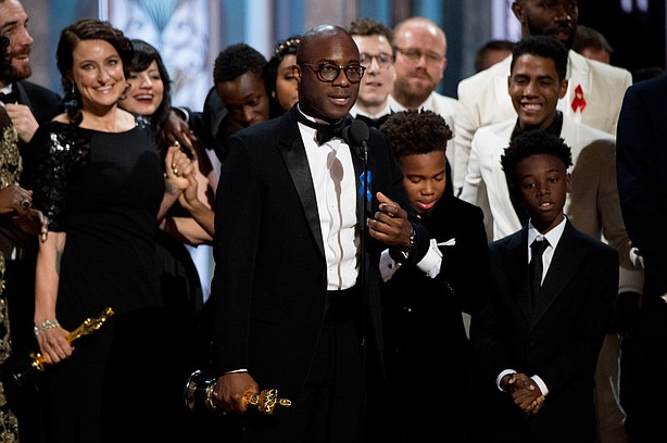 "Barry Jenkins, writer-director for ""Moonlight,"" onstage after hearing that ""L..."