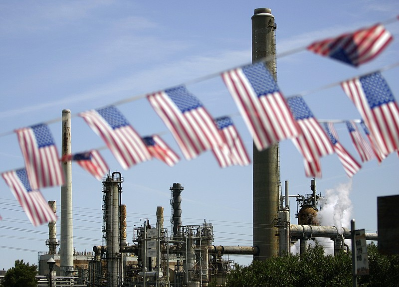 American flags are seen near the Shell refinery, in Martinez, Calif. Californ...
