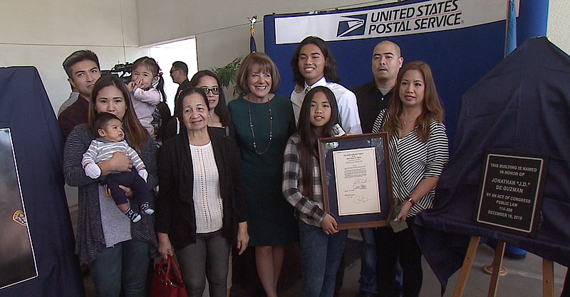 Congresswoman Susan Davis poses for a photo with De Guzman's family during Mo...