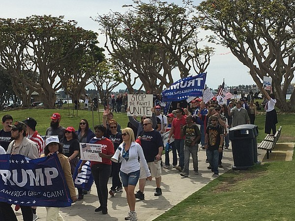 Supporters of President Donald Trump march along the San Diego Embarcadero as...