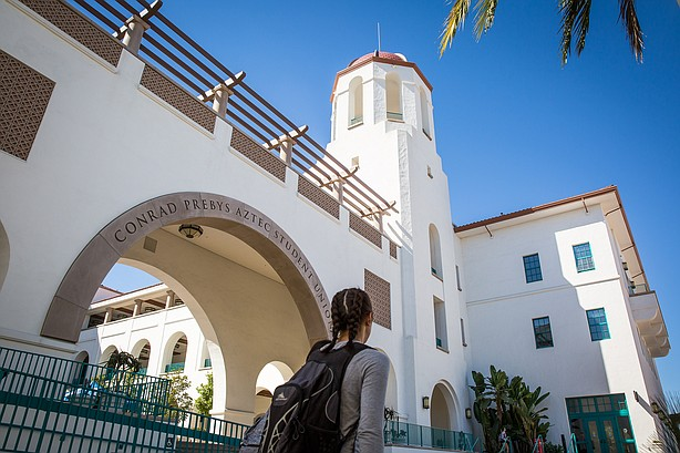 A student walks by Conrad Prebys Aztec Student Union at San Diego State Unive...