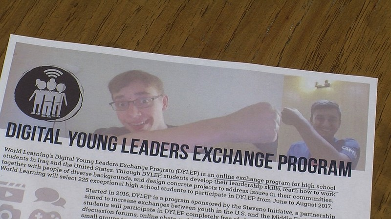 On a flyer for the Digital Young Leaders Exchange Program, two students engag...