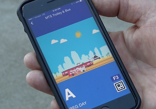 An MTS ticket bought with the new Compass Cloud app is displayed on a phone s...