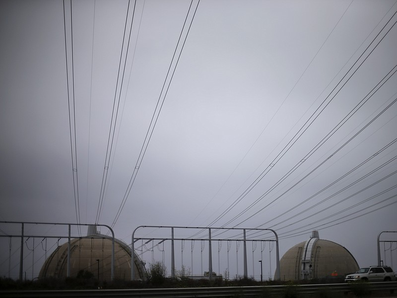 Power lines make their way over a freeway towards the San Onofre nuclear powe...