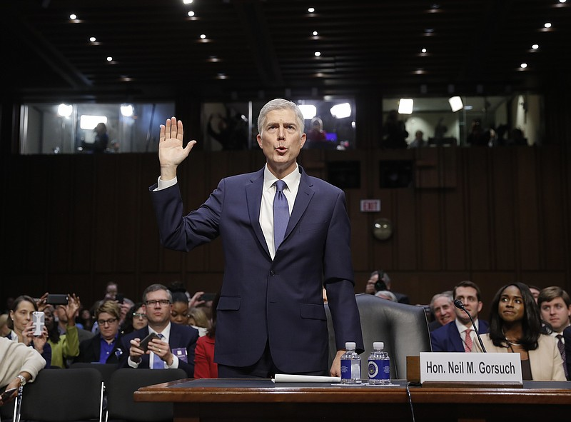 Supreme Court Justice nominee Neil Gorsuch is sworn-in on Capitol Hill in Was...