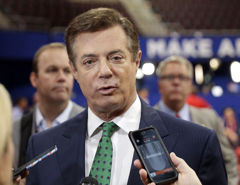 Trump Campaign Chairman Paul Manafort talks to reporters on the floor of the ...