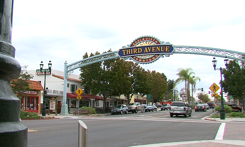 Cars pass under the Third Avenue sign in downtown Chula Vista, Oct. 7, 2014.