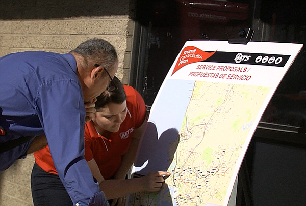 An MTS employee points on a map of proposed changes to the system's bus netwo...