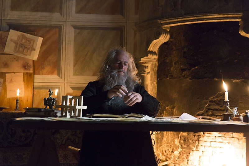 Re-enactment of Leonardo da Vinci as an old man at his desk.