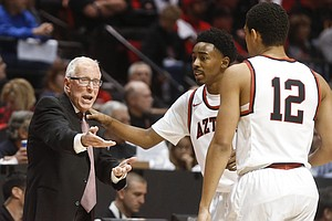 San Diego State Basketball Coach Steve Fisher Announces R...