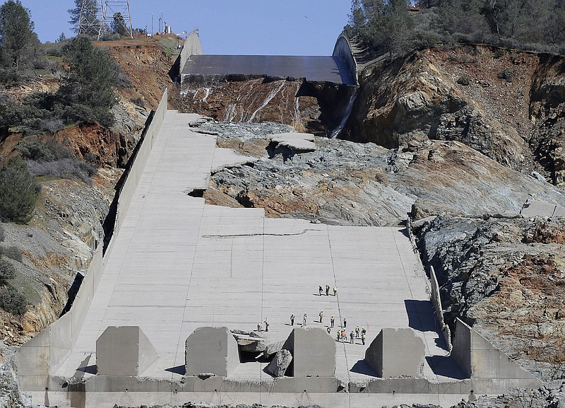 Officials inspect Oroville Dam's crippled spillway in Oroville, Calif., Feb. ...