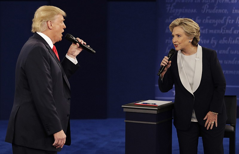 Donald Trump and Hillary Clinton speak during the second presidential debate ...