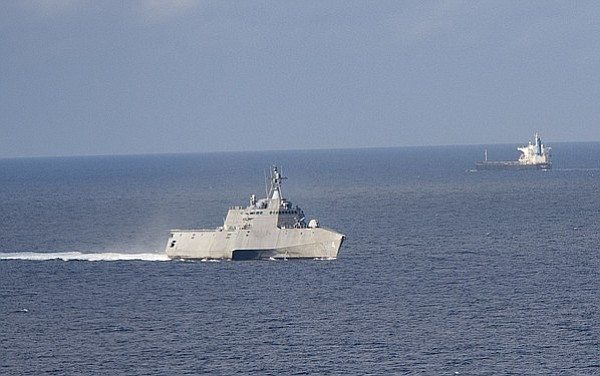 The littoral combat ship USS Coronado conducts operations in the Sulu Sea, Fe...