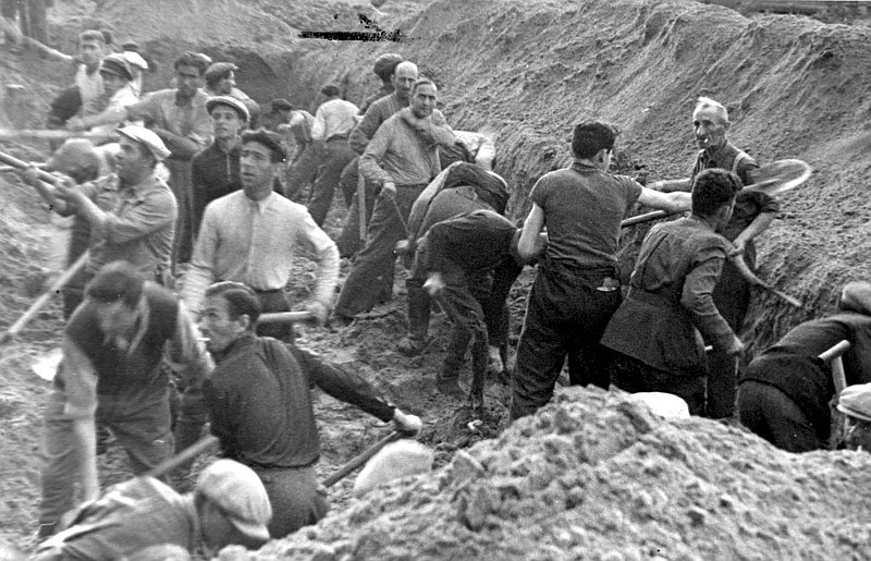 Ponary, Poland, Jews digging a trench in which they were later buried, after ...