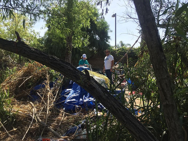 San Diego city councilman Scott Sherman surveys the garbage left