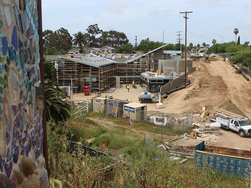 A view from a community park overlooks construction of Ocean Discovery Instit...