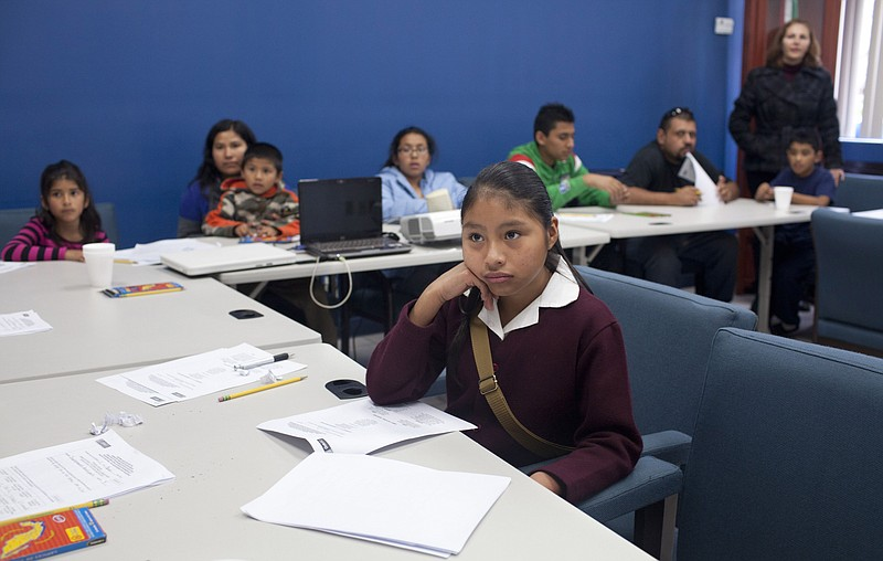 Children and their families take an adaptation course at the Binational Progr...