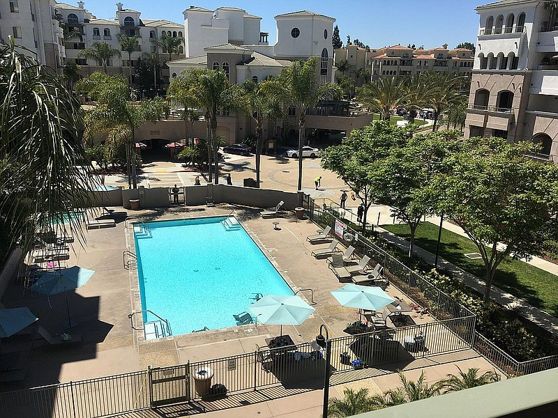 The photo shows the pool area at the La Jolla Crossroads apartment complex in...