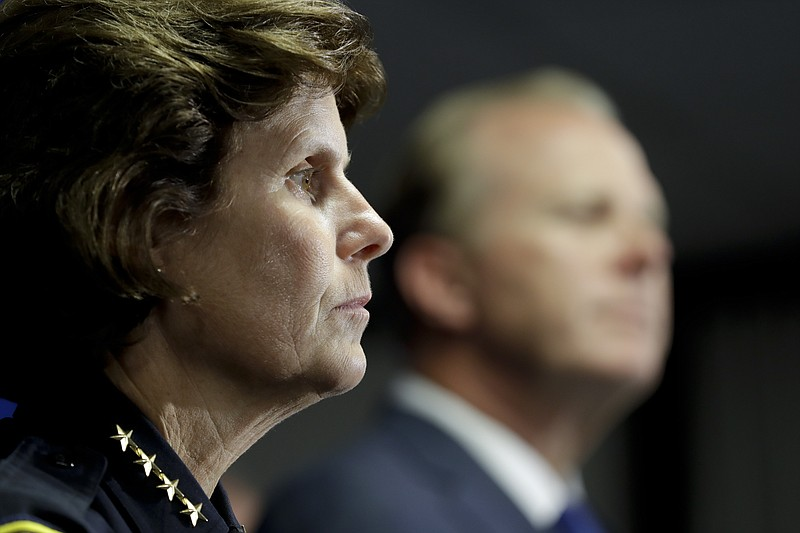 San Diego Police Chief Shelley Zimmerman, left, looks on alongside San Diego ...