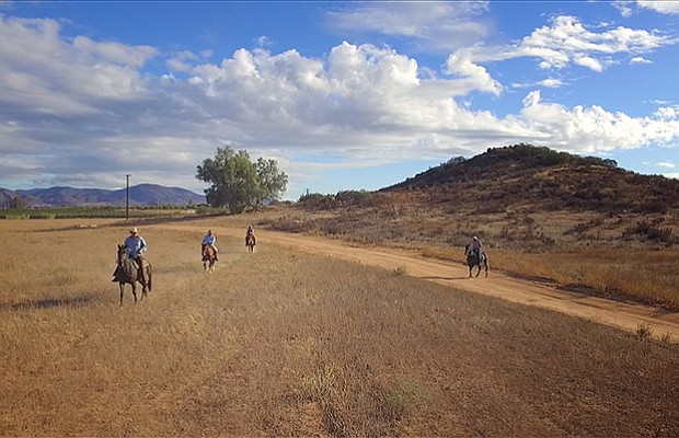 Host Jorge Meraz rides a horse in the Valle de Guadalupe wine country in Ense...