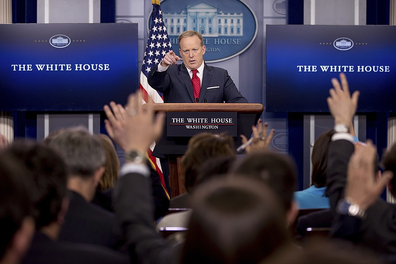 White House press secretary Sean Spicer calls on a member of the media during...