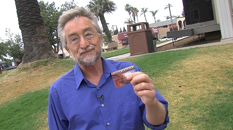 Bret Fisher holds up his Gold State Advantage card, which gives him access to...