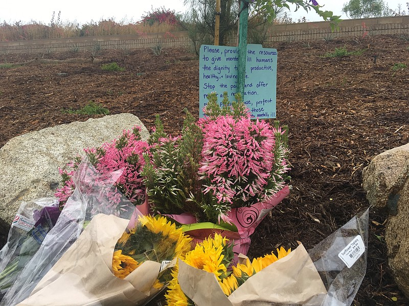 A memorial has been set up at Torrey Pines High School hours after the office...