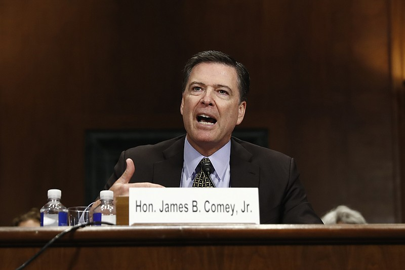 FBI Director James Comey testifies on Capitol Hill in Washington, Wednesday, ...