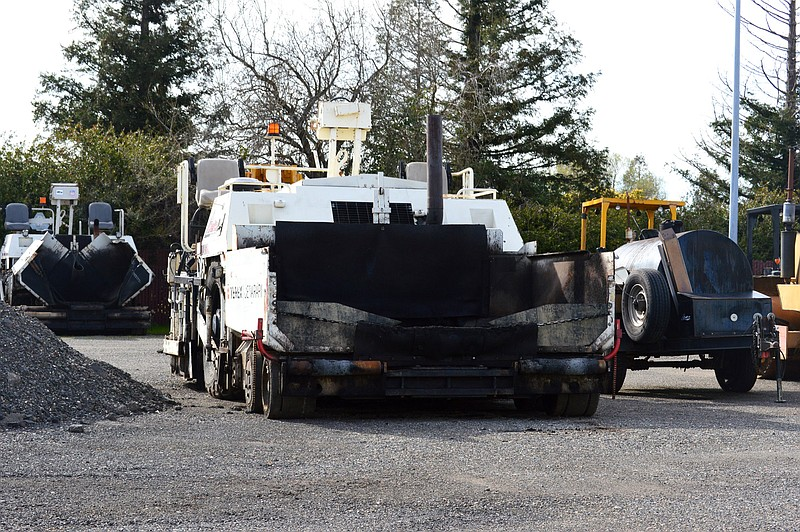 A highway paving machine in the yard of Skip Brown, whose Delta Construction ...