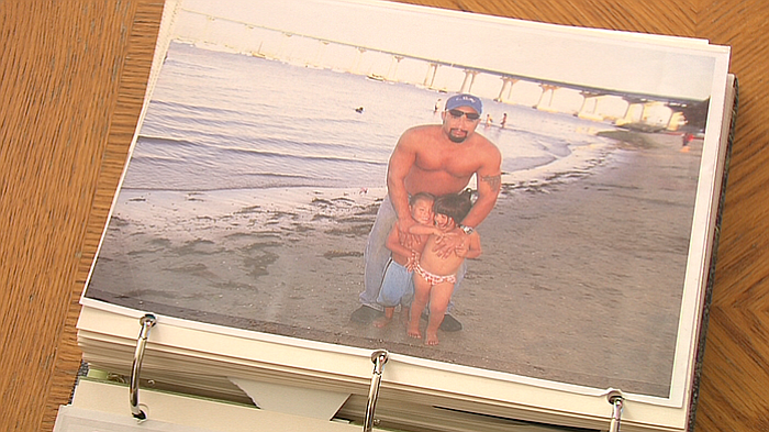 Anastasio Hernandez Rojas stands with two of his children at a Coronado beach...