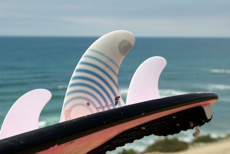 Smartfins, designed to fit on surfboards and capture ocean data, in an undate...