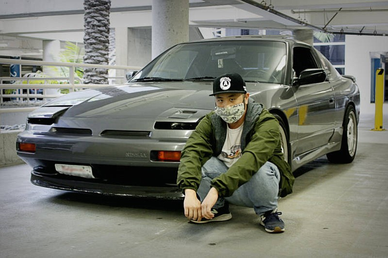 Alvin poses in front of his car, a Nissan 240SX. in this undated photo.