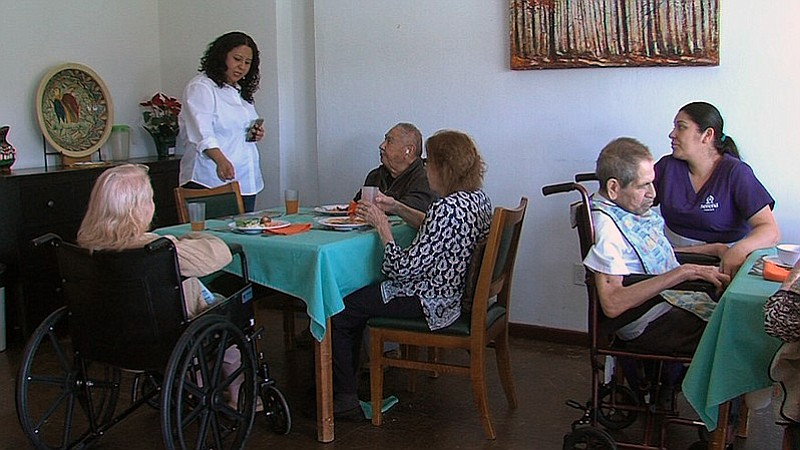 Serena residents eat in the dining area while Marisa Molina, Serena's operati...