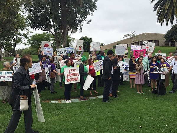 A group of National City residents rally for immigrant protections, June 6, 2...