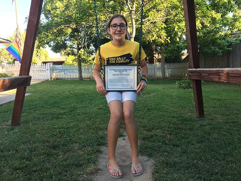 Kiera Kaiser with an award she received from the Fresno Center for Nonviolenc...