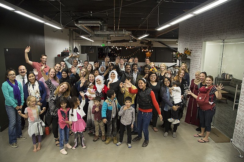 HireAHelper's staff pose with their friends, family and newly resettled Syria...