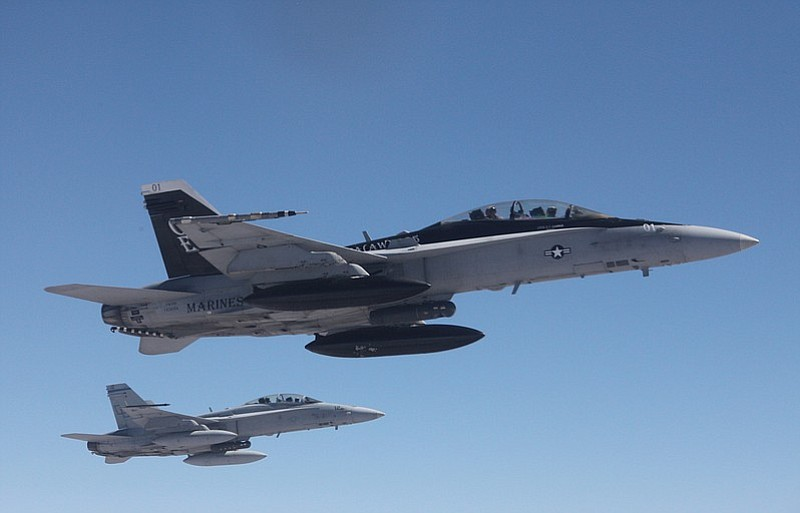 F/A-18 Hornets in flight.