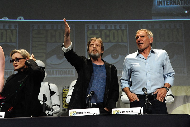 Carrie Fisher, left, Mark Hamill and Harrison Ford attend Lucasfilm's