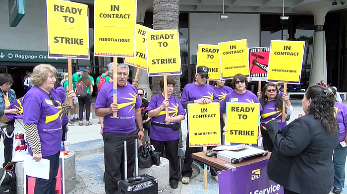 Janitors who work at the San Diego International Airport announce their inte...