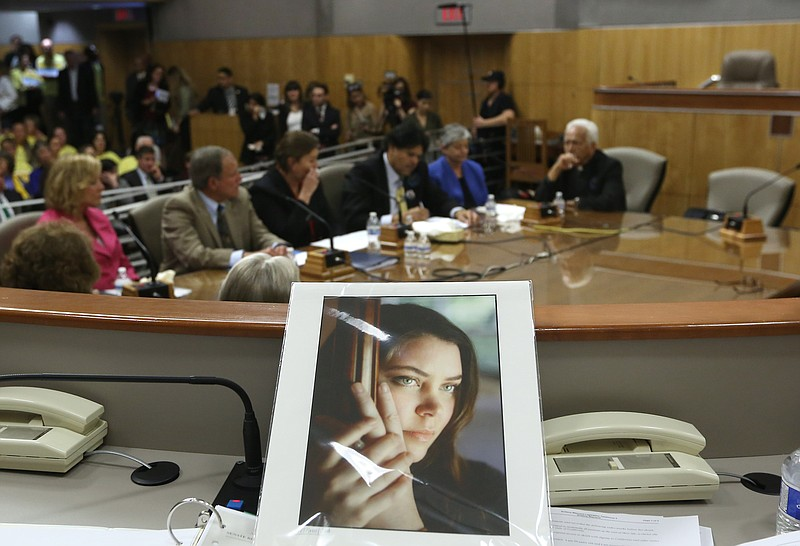 A portrait of Brittany Maynard sits on the dais of the Senate Health Committe...