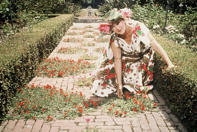 Madame Ganna Walska poses for a photographer in the garden in this undated ph...
