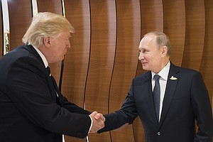 Grins And Handshakes As Trump Encounters Putin For 1st Time
