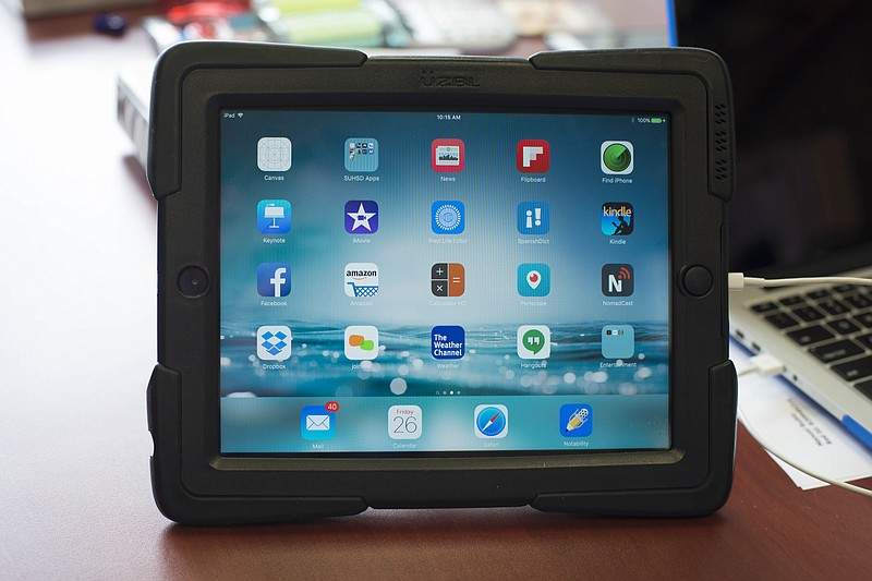 A Sweetwater Union High School District iPad is displayed in district offices...