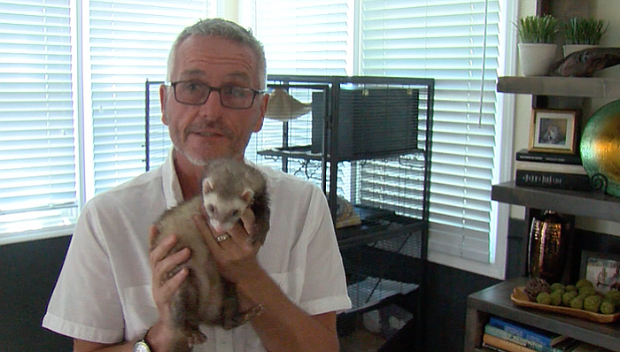 Pat Wright is shown with his pet ferret, Jethro, on July 7, 2017.