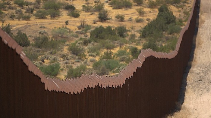 The U.S.-Mexico border fence stretches through southeastern San Diego County,...