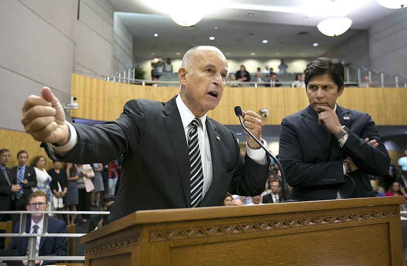 California Gov. Jerry Brown, left, joined by Senate President Pro Tem Kevin d...
